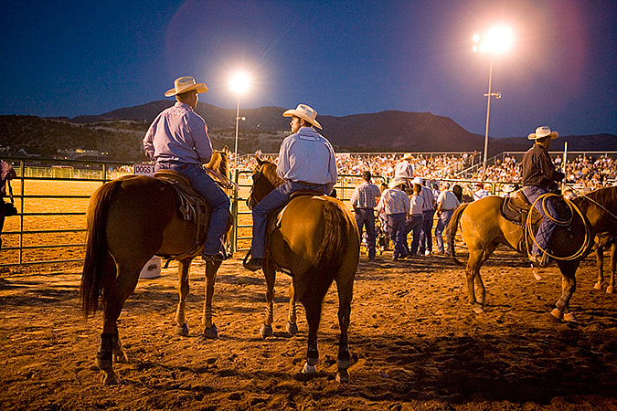Cowboys watching the show at the Iron County Rodeo, Cedar City, Utah